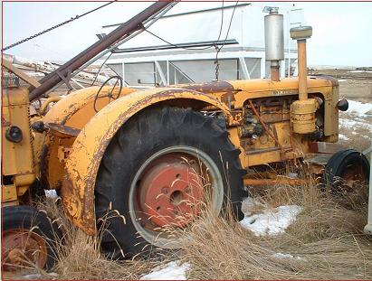 Go to two yellow 1955 Minneapolis Moline GB Diesel tractors for sale $3,500
