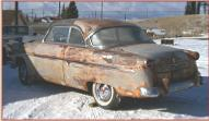 1954 Ford Skyliner 2 door glasstop hardtop left rear view